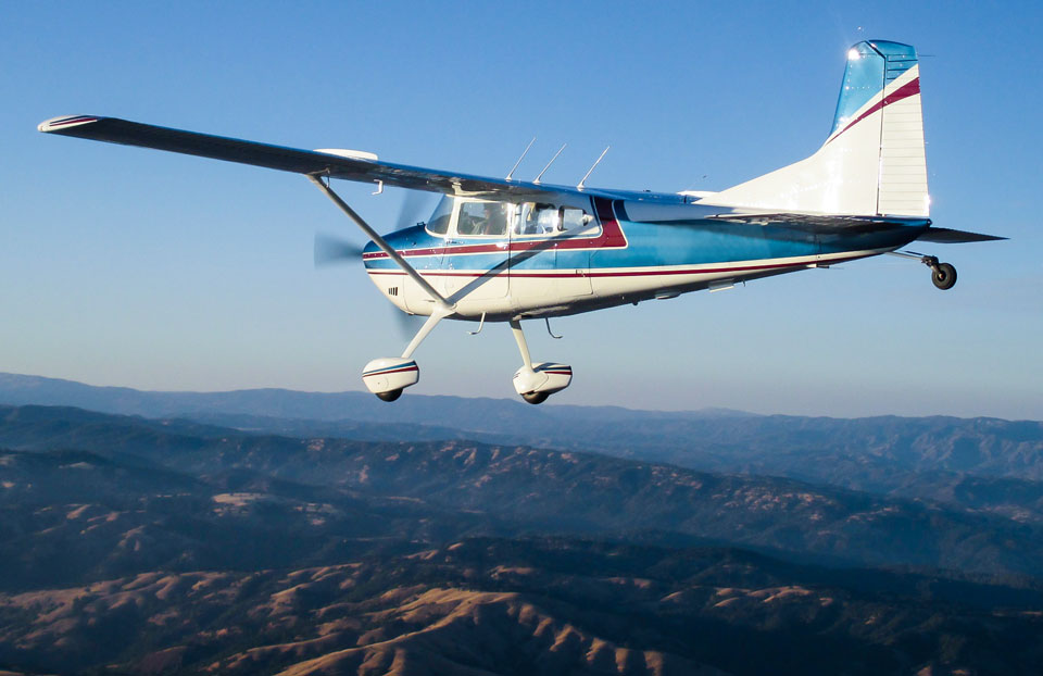 Cessna Flying over Desert